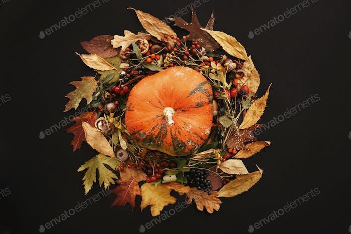 Happy Thanksgiving Flat Lay. Pumpkin in Fall leaves wreath