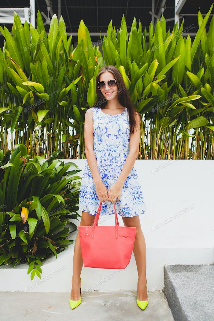 young stylish beautiful woman in blue printed dress summer style
