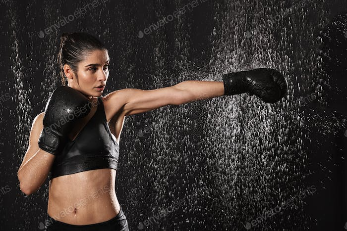 Female fighter 20s with perfect body in sportswear and black box