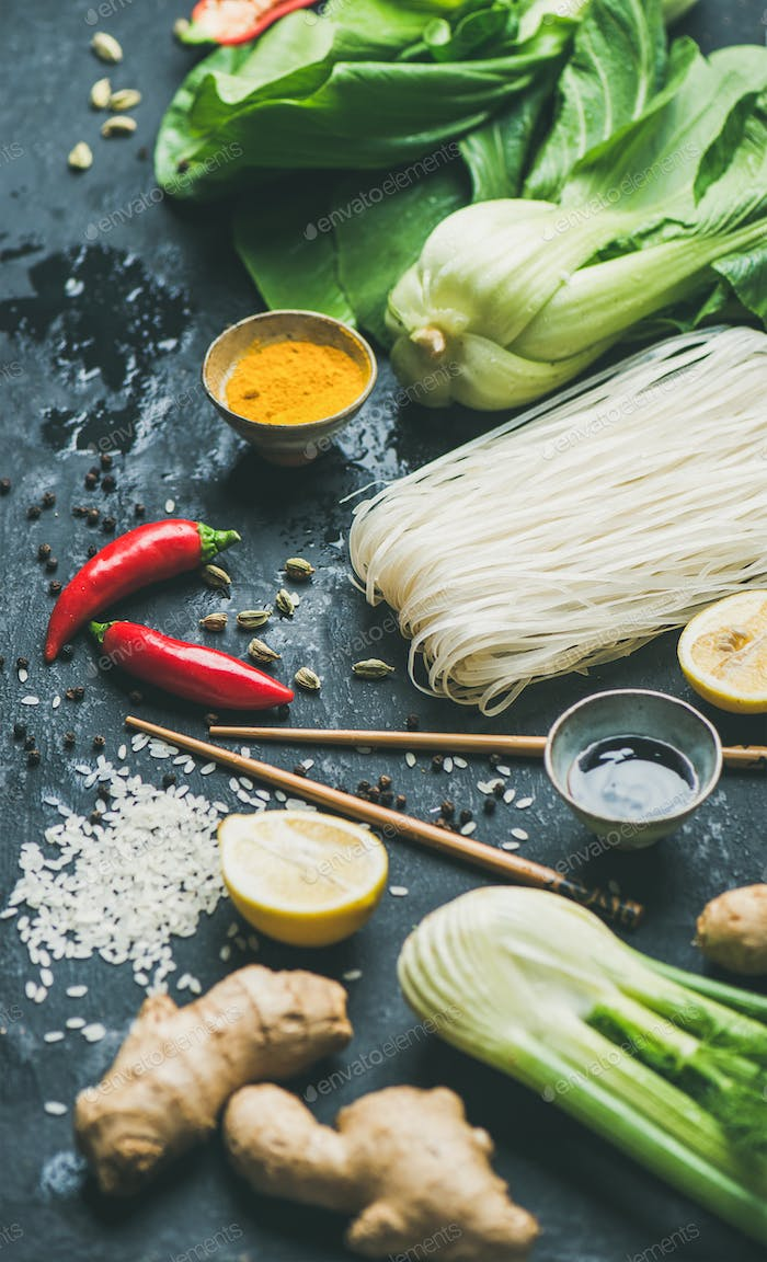 Asian cuisine ingredients over dark slate stone background, selective focus