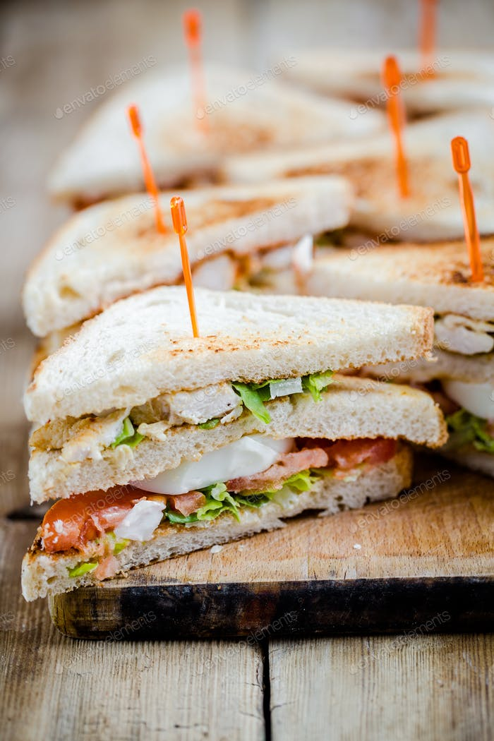 Club sandwich - a sandwich with egg, tomato and ham