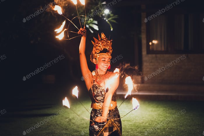 Balinese traditional dancing with fire show at evening beach party