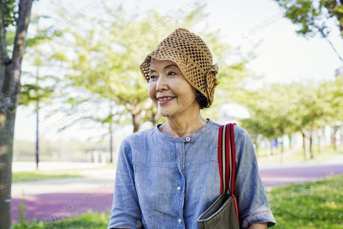 Portrait of a smiling senior woman wearing a crochet hat.