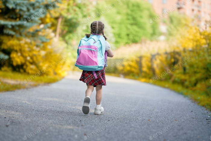 Girl with backpack is going to school