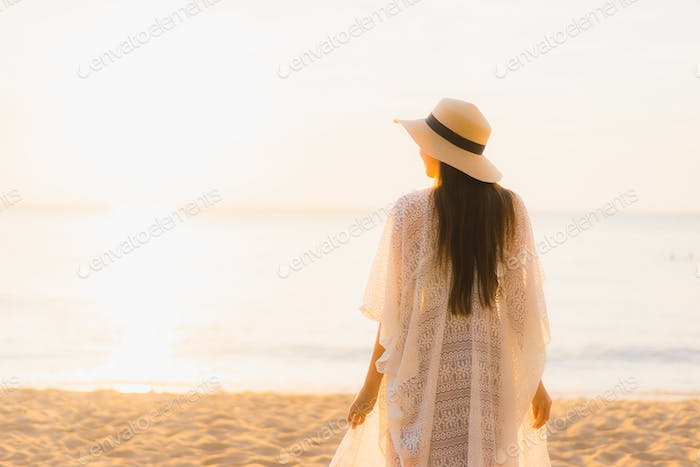 Portrait beautiful young asian women happy smile relax around beach sea ocean
