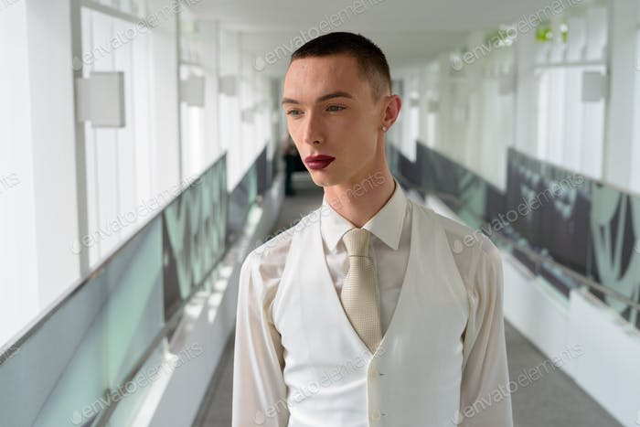Young androgynous homosexual LGTB businessman wearing lipstick