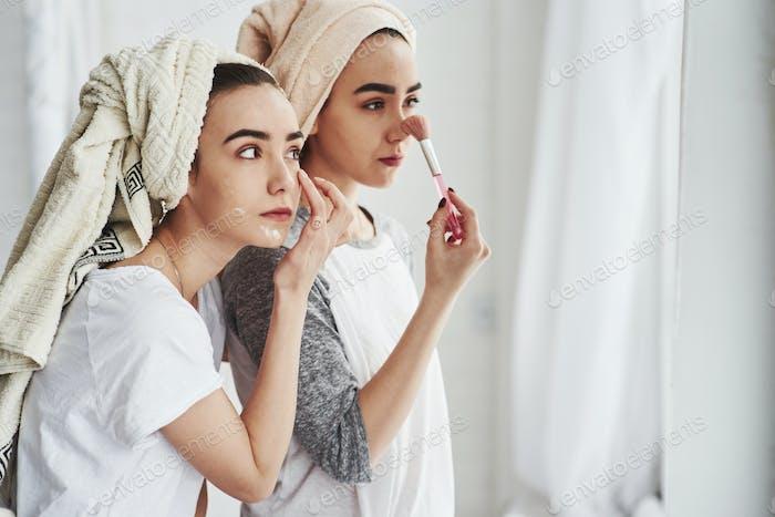 Two female sisters have weekend at bedroom