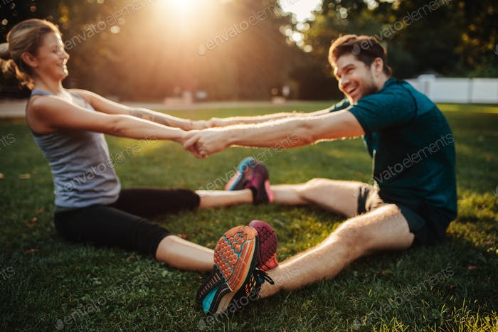 Young health couple doing stretching exercise