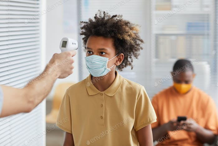 African-American Boy at Covid Safety Checkup