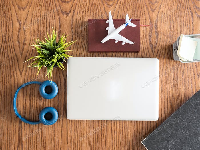 traveler businessman top view on wooden desk  concept image