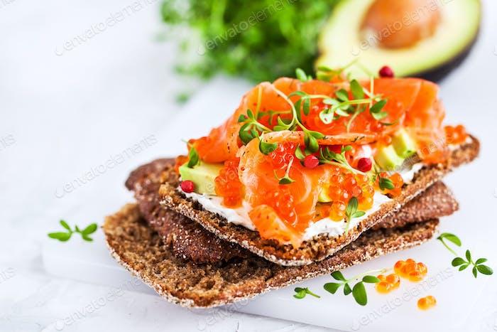 Salted salmon, red caviar, avocado and cream cheese rye crisp to