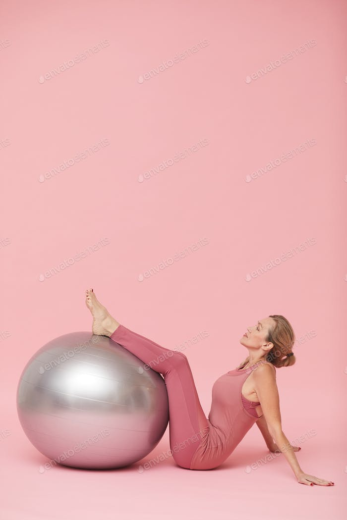 Mature Woman Exercising with Fitness Ball