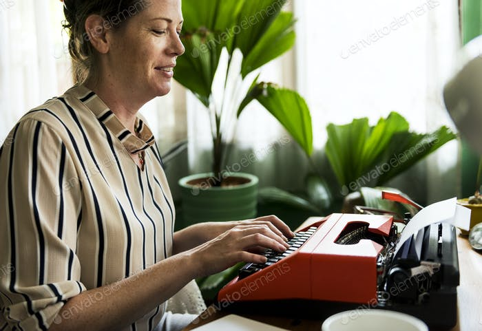 Woman typing on a retro typewriter