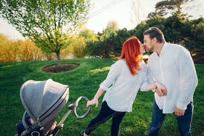 cute family in a sunny park