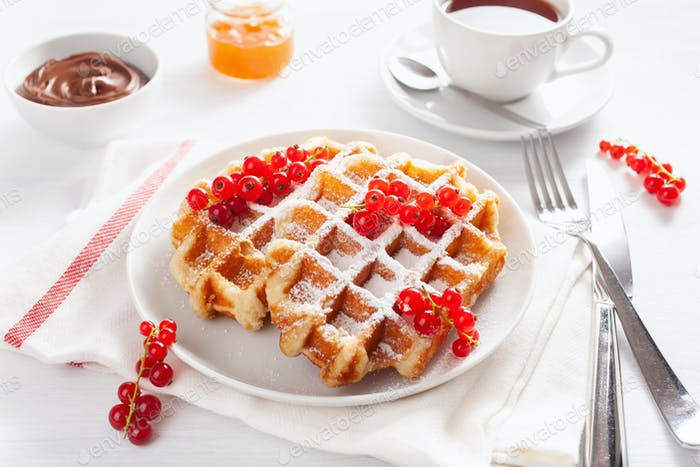 breakfast with waffle, berry, jam and tea
