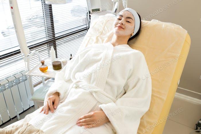 Asian Woman Relaxing in SPA
