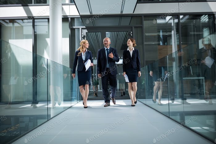 Businesspeople walking in the office