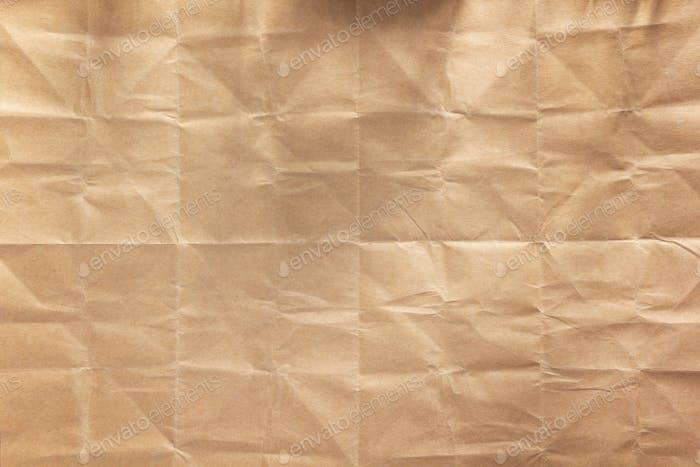 Zerknitterte Papiertextur als Hintergrundtextur. Gefaltetes Kraftpapier