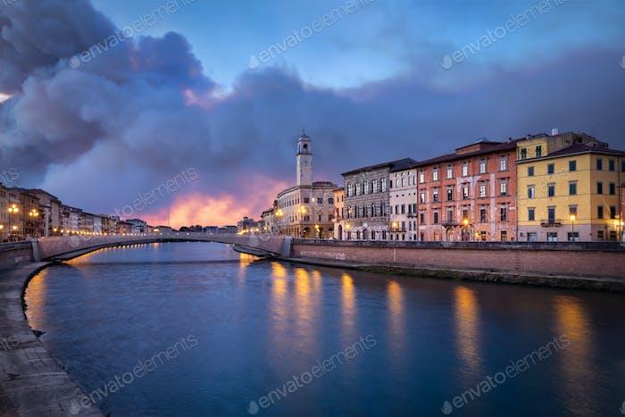 Arno river and Ponte di Mezzo bridge in Pisa