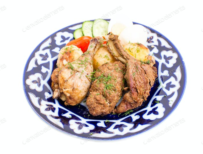 Delicious baked meat mix with garnish.