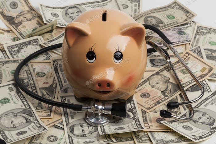 Piggy Bank and Stethoscope on Dollars