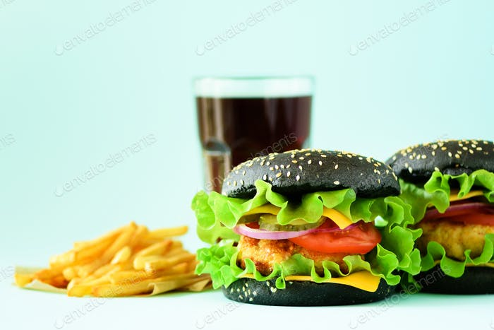 Homemade cheese burger or hamburger served with french fries on blue background. Copy space. Fast
