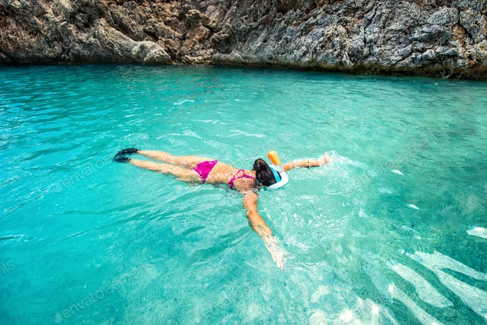 Concept of healthy living, sports and watersport details. Snorkeling with special equipment