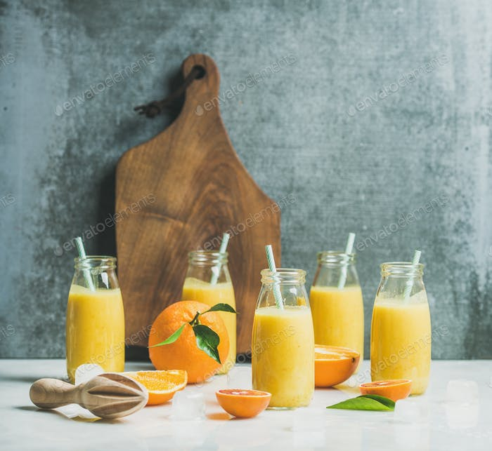 Healthy yellow smoothie with citrus fruit, copy space