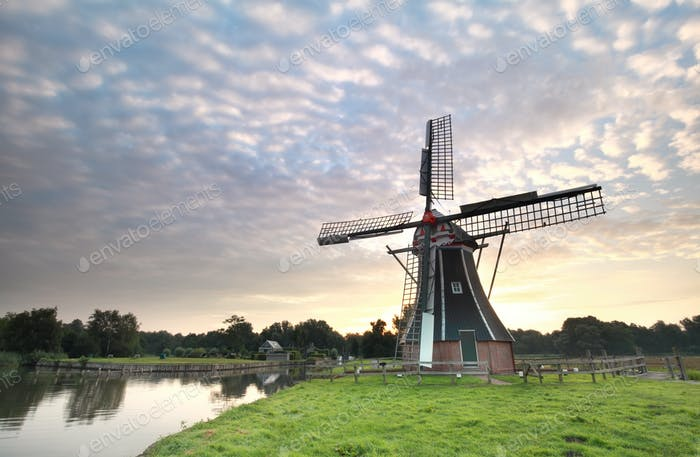 beautiful sunrise and Dutch windmill