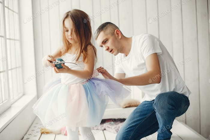 Father playing with a little daughter