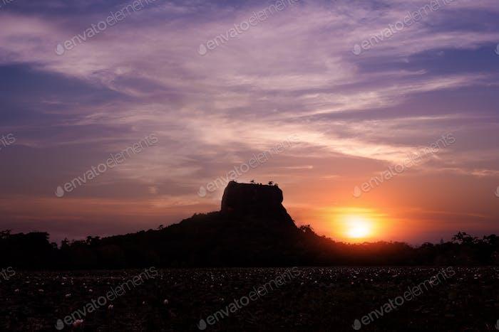 Sunset silhouette of Lion Rock. Sigiriya, Sri Lanka