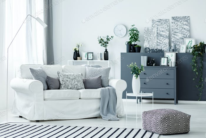 White sofa and grey accents
