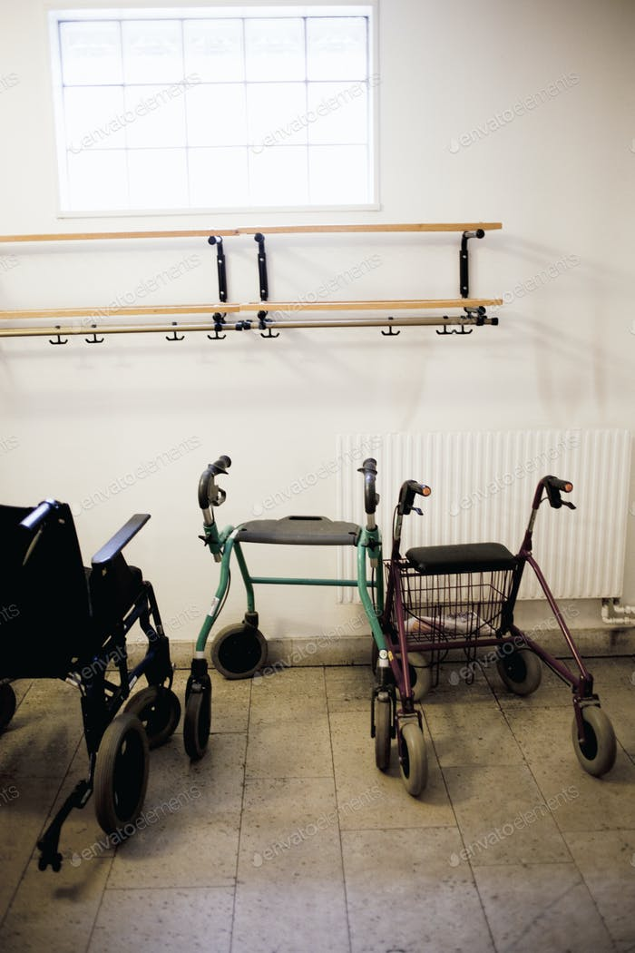 Rollators and wheelchair in room