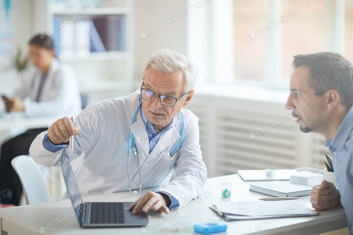 Doctor talking with patient about illness