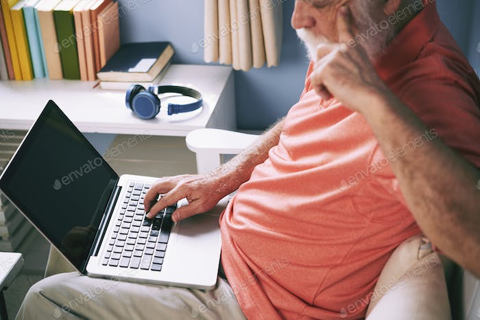 Elderly man surfing the net
