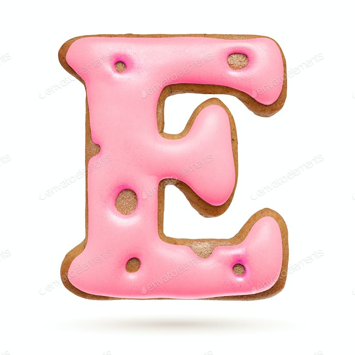 Capital letter E. Pink gingerbread biscuit isolated on white.