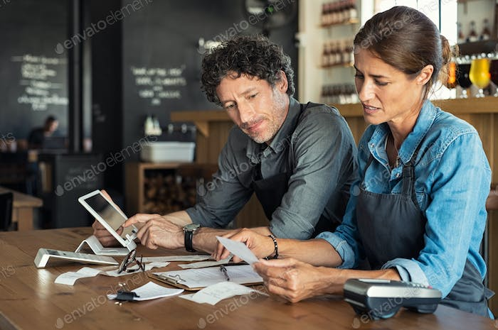 Staff calculating restaurant bill