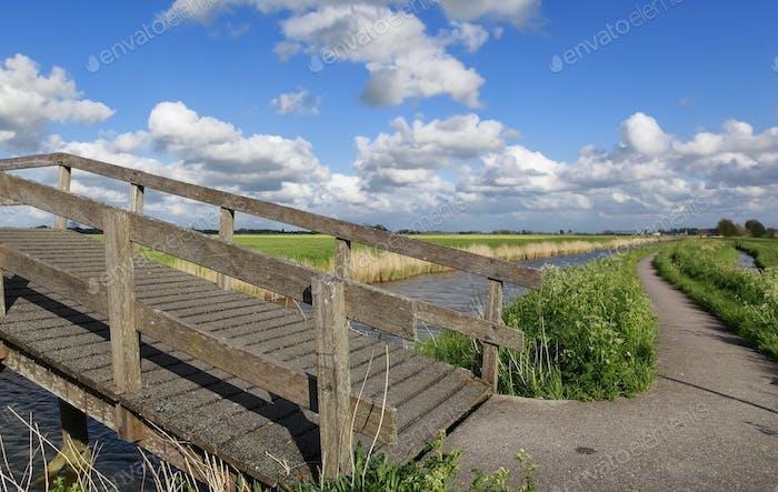 bike path and bridge via canal and blue sky