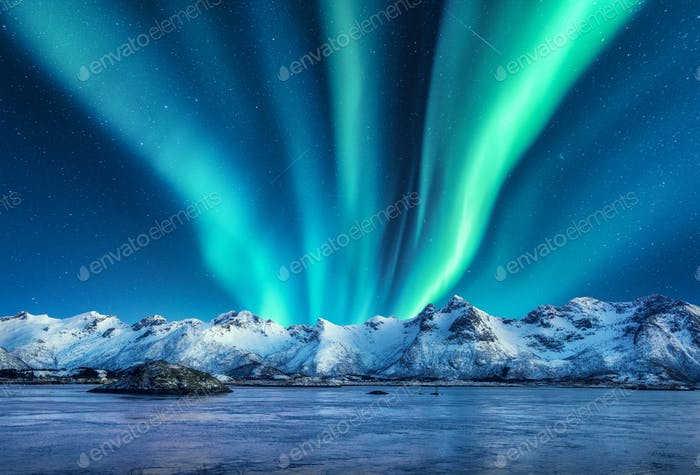 Aurora borealis above the snow covered mountains