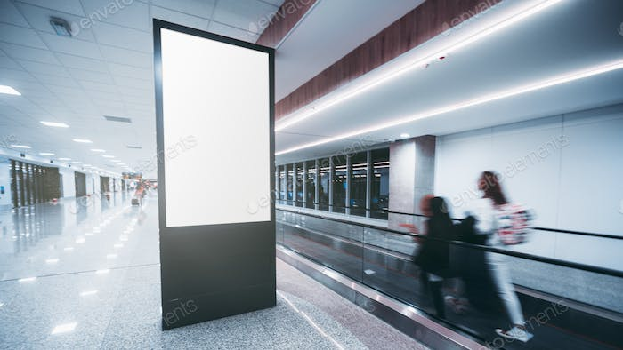 Vertical poster mockup in an airport