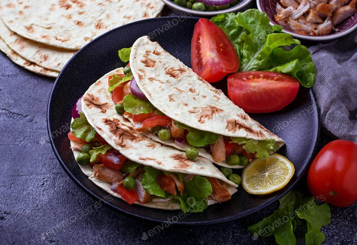 Mexican tacos with meat and vegetable