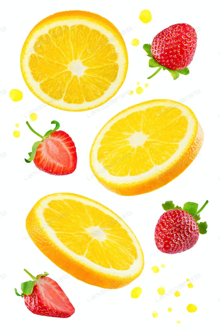 Flying Oranges with strawberries and juice's spray