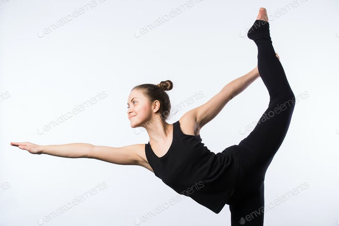Attractive Woman doing Standing Bow Yoga Pose