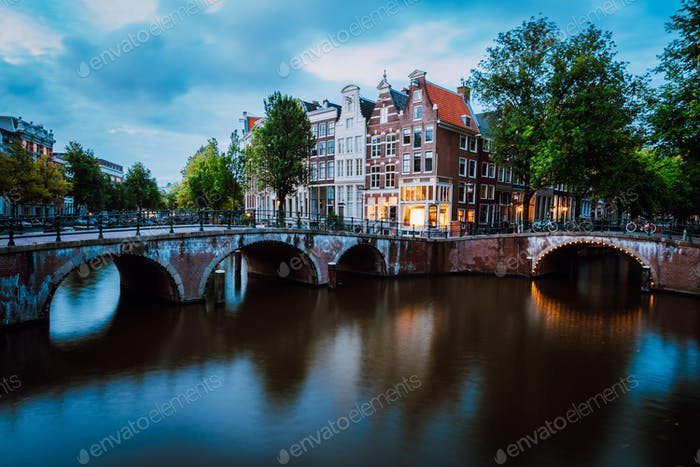 Famous Keizersgracht Emperor's canal in Amsterdam, dutch scenery with illuminated bridge at