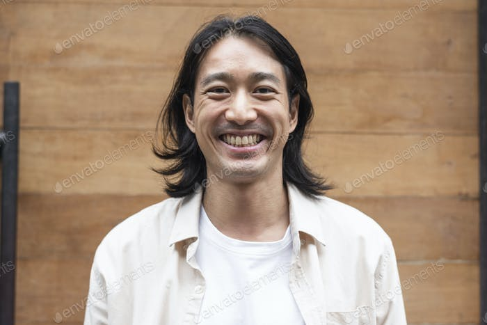 Happy long haired Japanese man