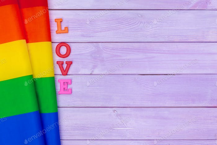 LGBT day concept. LGBT flag on the table