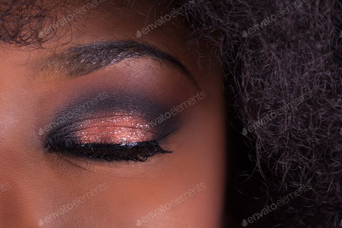 Close up make up closed eye of an African American woman