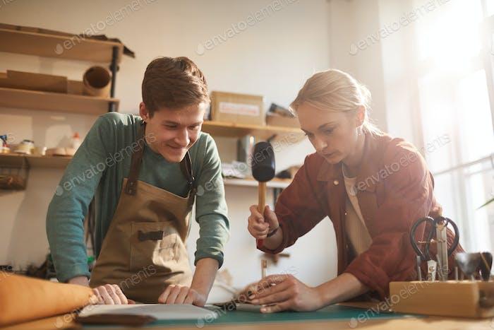 Two Modern Artisans In Workshop