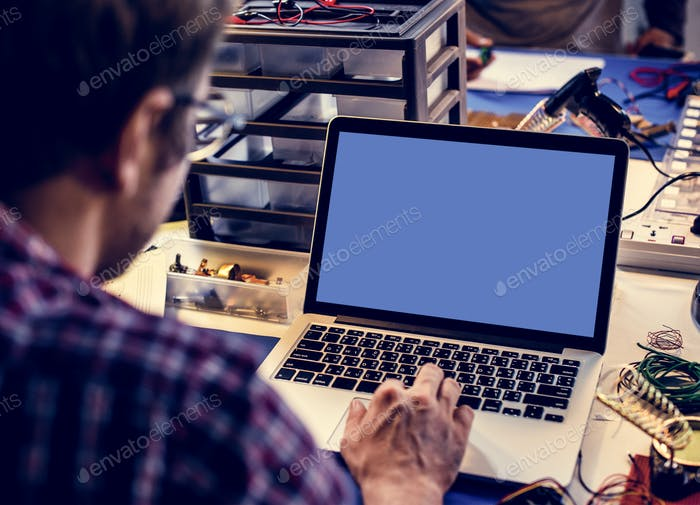 Computer laptop showing blank blue screen