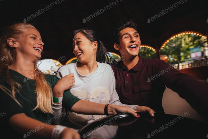 Group of friends on amusement park ride